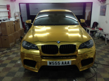 bmwx6-wrapped-gold-chrome