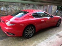 red-maserati-granturismo-before-pearl-white-wrap