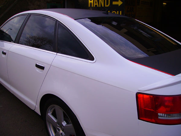 White Audi A Quattro Wrapping on Audi R8 Black